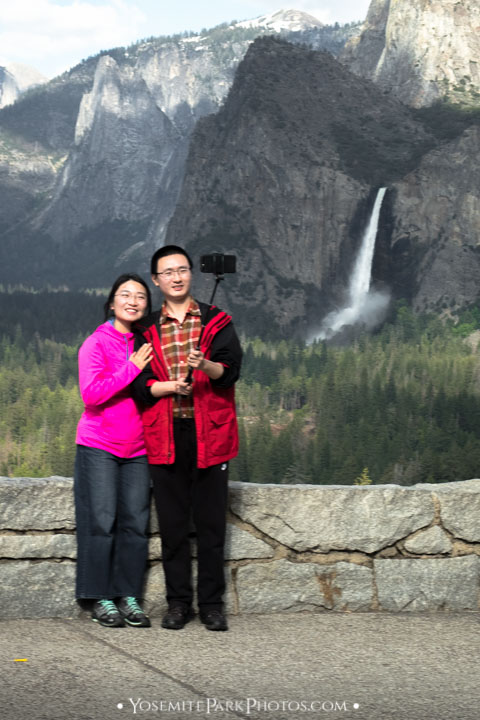 Young Chinese couple taking a picture at Tunnel View - Yosemite tourist selfies