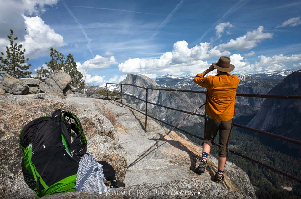 Wilderness backpacker scanning the horizon with binoculars - Yosemite Hikers