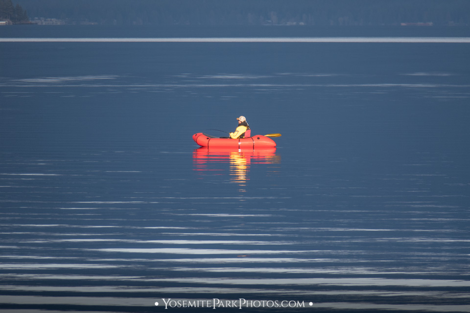 Kayaker fishing out on the lake