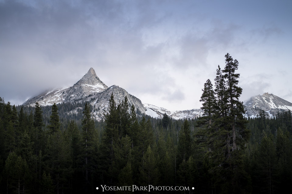 Perfect cone of Cathedral Peak with patchy snow, taken from highway 120 at Tuolomne Meadows