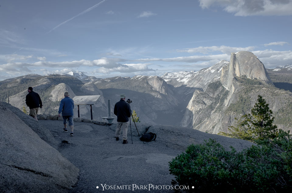 Photographer man set up with camer gear and tripod at Glacier Point, Overlooking Half Dome