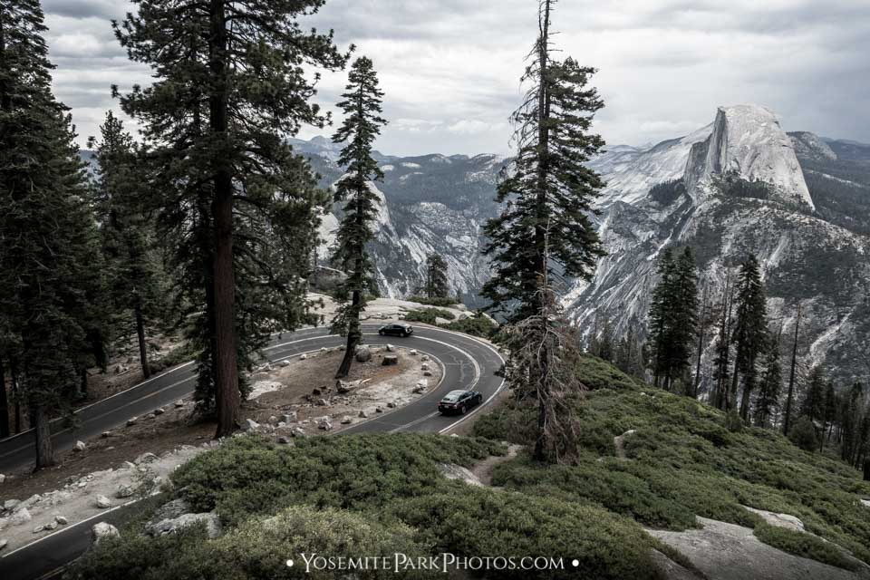 Overview of Glacier Point Rd hairpin turn and Half Dome on cloudy day