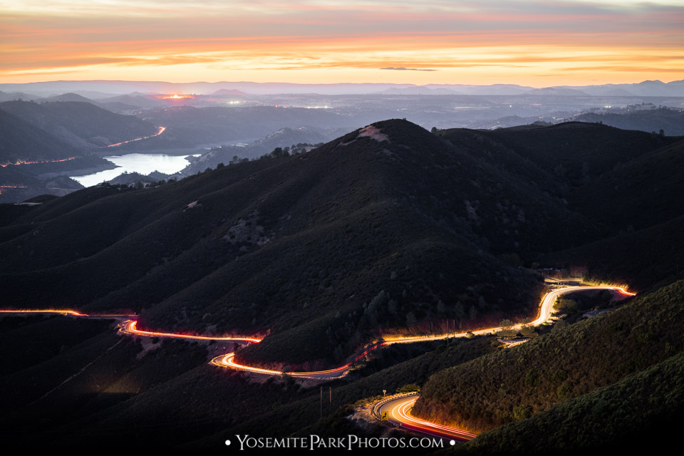 Car Headlights Driving Through The Foothills at Sunset - SR120, nearby Yosemite