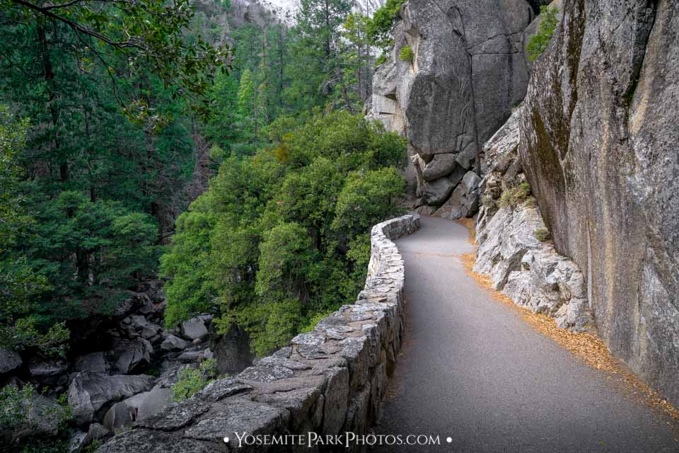Paved path and rock wall on mountainside - Yosemite Trails