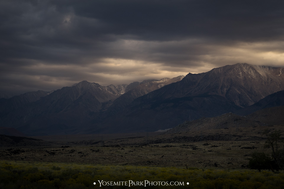 Stormy filtered light on the eastern sierra mountain peaks along 395
