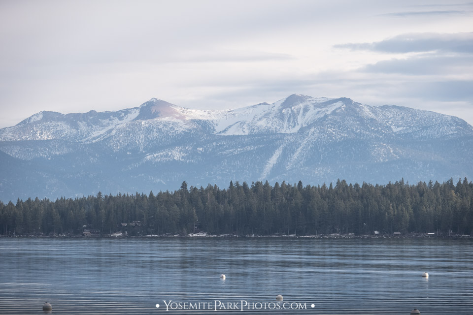 Snow capped mountains surrounding the water - Lake Tahoe Winter Photos