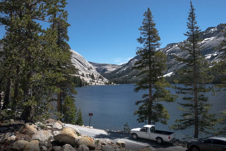 Tourist cars parked lakeside on Tioga Road