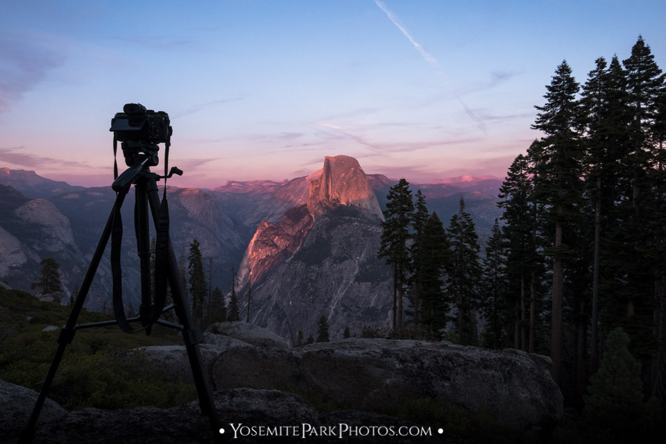 Camera & tripod setup photographing the iconic Half Dome sunset - Yosemite photography workshop