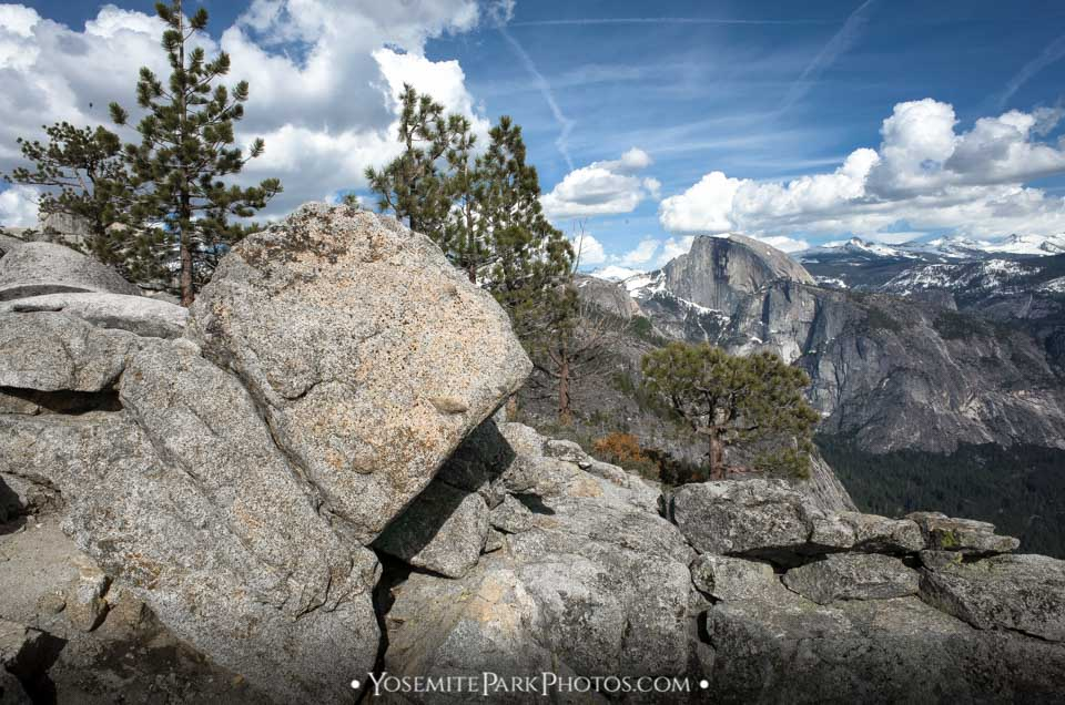 Granite boulders and sunny Half Dome clouds