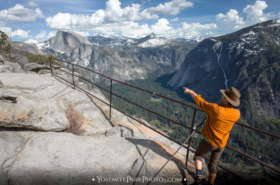 Hiker pointing to Half Dome - Yosemite Point photos